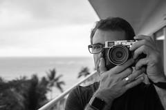 Hawaii_July_2016-7300.jpg (labrossephotography) Tags: monochrome bw selfportrait man outside mirror leadinglines fujifilm x100s person hawaii waikiki vacation holiday lanai palmtrees narrowdof bokeh applewatch