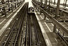 F Train Enters Stillwell Ave/Coney Island Station (Robert S. Photography) Tags: subway station fromabove terminal train incoming tracks coneyisland stillwellavenue brooklyn nyc sepia canon powershot elph160 iso400 july 2016