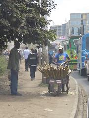 Sugarcane vendor (prondis_in_kenya) Tags: kenya nairobi colddryseason traffic jam congestion sugarcane seller vendor wheelbarrow