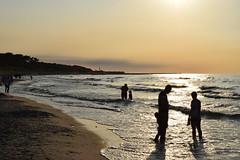 Beauty of beach (navarrodave80) Tags: beach water silhouette clearsky yellow people waterplay nikon d3300 davechmiel chmiel