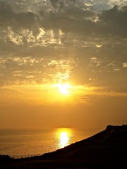 Mellow Sunset (bimbler2009) Tags: fujifilms9900w sunset water sea ocea reflections movement motion silhouette urbanlandscape sun sky clouds serene