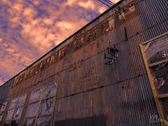 The Welding Shop (Warren06) Tags: urbandecay decrepit rust welding corrugated metal street sunset orange sign vancouver britishcolumbia rundown sky clouds