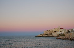 magic and Vieste (ΞSSΞ®®Ξ) Tags: camera city pink blue light sunset sea summer vacation sky italy white church water colors beautiful weather june yellow night composition contrast photography evening soft waves mood peace view angle wind pentax cloudy pov walk magic perspective scenic gimp hour panoramica framing tones bianco puglia vieste vastness k5 celeste gargano