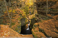 Pewit's Nest Autumn (kevin-palmer) Tags: autumn orange color green fall water leaves yellow rock wisconsin waterfall moss october colorful stream pentax deep canyon falls filter gorge swirl flowing polarizer baraboo swirling kx saukcounty statenaturalarea tamron1750mmf28 skilletcreek pewitsnest