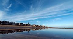 October blues (Lee Kindness) Tags: blue sea sky reflection beach water clouds scotland seaside sand edinburgh unitedkingdom wideangle spire portobello firthofforth joppa l10 714mm