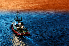 pilot boat (L F Ramos-Reyes) Tags: morning sea colors sunrise reflections dawn lights boat wake harbour aegean greece ripples pilot pilotboat mykonos underway aegeansea lionfrr mygearandme