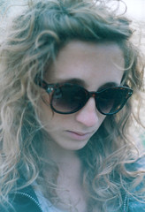 Giorgia, bianco (Silvia Lavinia Segantin) Tags: light portrait sunlight white girl beautiful sunglasses leather closeup backlight canon jacket curly blonde fujifilm rays controluce helios fujicolor helios58mm canoneos300x