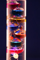 Day 346 - Galileo thermometer (Ben936) Tags: light reflection refraction colourful galileothermometer floatingweights
