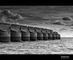 Breakwater (esslingerphoto.com) Tags: uk greatbritain sea england white black english water architecture marina canon concrete photography eos coast fishing fisherman brighton europe exposure village britain south architectural single channel breakwater esslinger esslingerphotocom