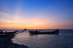 Sunset glow (Ted Tsang) Tags: olympus em1 1240mmf28 landscape sea silhouettes sky wetlands beach ship boat wave longexposure bluehour magichour taiwan lugang seascape reflections nd106
