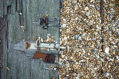 Fallen Door (the justified sinner) Tags: justifiedsinner wood rust corrosion beach shingle dungeness kent coast sea seaside panasonic 17 20mm gf1