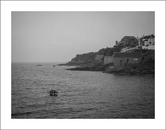 Porthleven I (Christa (ch-cnb)) Tags: cornwall england uk english channel porthleven coast harbour historic fishing port rain fog boat blackandwhite olympus omd em5mkii microfourthirds mzd1240mm pro zuiko