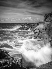 Port Gaverne Bay (Nigel Wallace1) Tags: seascape portrait sea waves portgaverne cornwall uk eng england atlantic longexposure slow exposure blackandwhite clouds explore danger rocks texture patterns olympus omdem1
