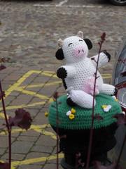 Herriot Yarnbombing cow (Nekoglyph) Tags: thirsk yorkshire centenary yarnbombing publicart knitting wool street jamesherriot heritage veterinary milk bottle udders cow black white carpark bollard plants cobbles marketsquare animal pink crochet