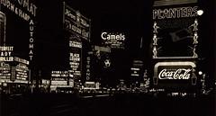 Times Square, January 13, 1937. (michaeldonovan22) Tags: newyorkcity nyc timessquare january131937 wednesday neon counterfeitlady ralphbellamy planters cocacola monochrome blackwhite camels canadianclub missinggirls ethelclayton nighttime cityscape safe blackleigon humphreybogart bertlahr michaeldonovan michaeldonovan22