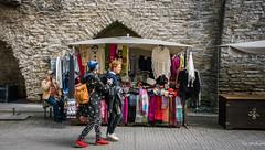 2016 - Baltic Cruise - Tallinn Estonia - Shoppers (Ted's photos - For Me & You) Tags: tedsphotos 2016 tallinn tallinnestonia estonia cellphone merchant kiosk vendor selling streetscene people peopleandpaths backpack cropped vignetting unesco unescoworldheritagesite scarves scarfs