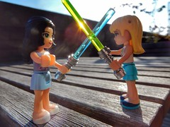 Friends or not (sander_sloots) Tags: lego friends light saber sabers minifig duel lichtzwaard lichtzwaarden starwars table tafel balkon zon zonlicht reflectie bokeh emma stephanie