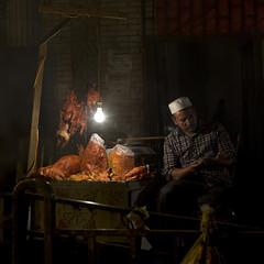 Night market, Xinjiang China (Eric Lafforgue) Tags: china muslim uighur tajikistan  uyghur kyrgyzstan kina chin cina chine ethnicity xina   peoplesrepublicofchina turkic tiongkok  chiny  kna in  ethnicgroup    0980 trungquc na   kitajska tsina      xinjianguyghurautonomousregion ougour   easternandcentralasia turkicethnicgroup chinacinachinechinyincinanakinaknakitajskationgkoktrungquctsinaxinachin