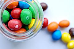 untitled (brescia, italy) (bloodybee) Tags: stilllife food macro glass colors mms candy sweet chocolate sugar m jar peanut
