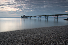 Clevedon Pier I (steve_thole) Tags: uk blue sunset sea england sky seascape colour reflection beach clouds landscape coast pier seaside still nikon rocks dusk victorian somerset pebbles hightide clevedon d300 bristolchannel clevedonpier