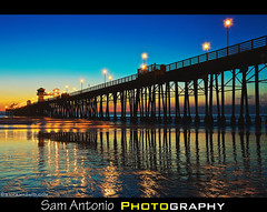 What famous 1980s movie was filmed nearby the Oceanside Pier? (Sam Antonio Photography) Tags: california wood blue sunset sea sky usa cloud reflection beach nature silhouette yellow horizontal outdoors photography pier day nopeople goose illuminated oceanside remote bluehour topgun scenics absence tranquilscene movielocations traveldestinations colorimage beautyinnature horizonoverwater builtstructure canoneos5dmarkii topgun1986 samantonio illuminatedpier topgunhouseoceanside oceansidepiersunset mavericktopgun tomcruisetopgun topgunimax3d topgun2013 topgunmovie sandiegofilmlocations charlieshousetopgun topgunoceanside topgun3d sandiegomovielocations