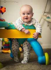 Blakely-in-Bright-Starts-chair (MAZ.Photography) Tags: baby silly smile canon walking toys happy 50mm child flash joy son speedlight nyip babytoys niftyfifty 60d activitystation 430exii brightstarts