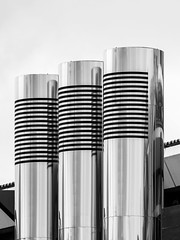 Three Pillars - Porsche Zuffenhausen, Germany (Sebastian Bayer) Tags: silver building shining abstrakt dach gebude stahl 300f4pro belftung schwarzweis glanz porschezuffenhausen technic mft architektur blackandwhite reflection porsche lessismore mirrorless omdem5ii metall symmetrie abstract architecture symmetric kunst steel roof rohre pipes technik sky spiegelung shine silber climatisation metal