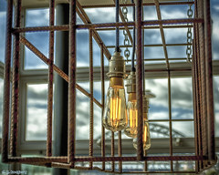 Capturing The Light (whistlingtent) Tags: light sky cage bulbs filament tyne bridge dof depth field bokeh blue rusty wire chains glass window arch orange pitcher piano pub perfect x lines curves angles