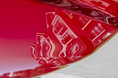 Reflections on a Car Hood (Doug.Mall) Tags: dogwood52 52weeks apartment artistic building challenge color photochallenge architecture carhood red reflection northcarolina usa