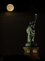 Liberty Harvest (Jersey JJ) Tags: libertyenlighteningtheworld statue liberty lady full harvest moon after dark nyc new york harbor island