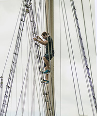 High Above Man Prepare To Sail The Seven Seas (nrhodesphotos(the_eye_of_the_moment)) Tags: dsc07507160 theeyeofthemoment21gmailcom wwwflickrcomphotostheeyeofthemoment waterfront metal hudsonriver candid mast spar man rope ladder pulley wires boat sloop schooner sailingship touristboat batterypark manhattan nyc people transportation