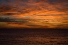 Fire in the Sky (tpatt83) Tags: flame orange red radiant vibrant nature atlantic rockport 2016 clouds water shore bassrocks atlanticroad beach goodharbor massachusetts mass ma gloucester ocean sunrise sky fire