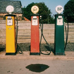 Pumps (Peter.Bartlett) Tags: urbanarte urban lunaphoto peterbartlett petrolpumps iphone5s mobilephone cellphone three trio puddle fence fuelpump gasolinepump square vsco shell bp
