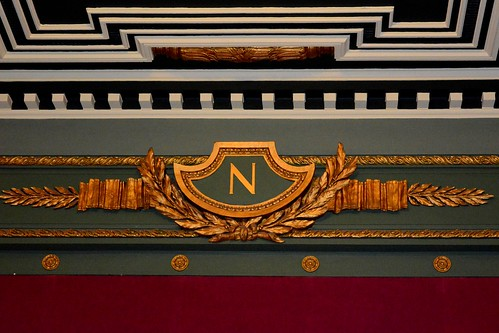 N emblem above stage, representing Neptune, the theatres previous name