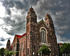 "Cathedral's ""Stormy Past"" (Jan Nagalski) Tags: church cathedral stpetercathedral romanesque gothic colorful dome sandstone marquettesandstone clouds storm stormclouds darksky threatening turbulent marquette michigan jannagalski jannagal weather nationalregisterofhistoricplaces stonewall redroof red orange blue gold"