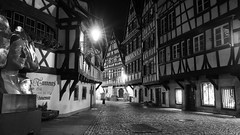 just follow the Route de Choucroute ... ;) (lunaryuna) Tags: france lalsace strasbourg lapettitefrance ruedesmoulins timberframehouses historiccitycentre touristhotspot architecture buildings beautyofdesign night nightlights nightphotography nocturnalphotography cobblestonealley restaurants blackwhite bw monochrome lunaryuna urbanconstructs walkinthecity