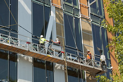 "Workers install siding (See: http://www.flickr.com/photos/bullitt_center/ for usage information) • <a style=""font-size:0.8em;"" href=""http://www.flickr.com/photos/87145936@N05/8100858792/"" target=""_blank"">View on Flickr</a>"