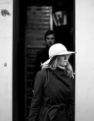 Moody (IAWPhotos) Tags: blackandwhite bw london zeiss candid streetphotography wintercoat westend widebrimmedhat zf2 planart1450mm walkingwithmynikon caranabystreet d800e