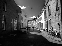 Single rider on Singelstraat (aylmerqc) Tags: blackandwhite bw woman brick netherlands bike bicycle canal alone rider g11 canong11 middelburgnl