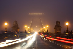 Budapest - the Chain bridge covered in fog at new year's eve 12 (Romeodesign) Tags: road street old longexposure bridge winter light mist fog night lights haze hungary nebel traffic walk strokes crowd budapest perspective statues move front chain lions fade lamps duna brcke verkehr danube atmospheric buda nightfall disappear 550d gettyhungary1