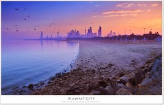 Kuwait City - The morning birth (khalid almasoud) Tags: city morning trees light sky beach birds misty skyline canon eos rocks flickr moments all photographer space  birth towers sp ii shore rights 7d estrellas di if kuwait af tamron khalid reserved f28 xr ld photographing hover  icapture  aspherical    january19  greatphotographers   2013   1750mm photographyrocks almasoud flickraward