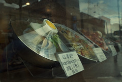 Tension (Kim Yokota) Tags: street toronto ontario canada bokeh noodles fakefood cellophane widowdisplay moolnaengmyun nikond7000 nikonafsnikkor24mmf14ged