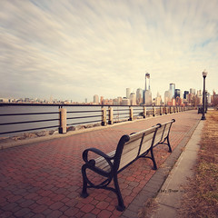 Sit and enjoy the view. (dog ma) Tags: longexposure newyorkskyline libertystatepark dogma leadinglines jerseycitynj