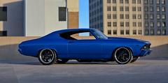 1969 Chevelle (JasonLubken) Tags: lighting city blue cars chevrolet skyline canon vintage photography driving cityscape chevy 10d restored classiccars 69chevelle