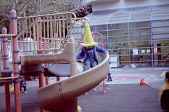 - /\ - (corliss ng) Tags: school boy usa sun film playground america canon vintage children happy lomo lomography san francisco play little cone ae1 slide kindergarden