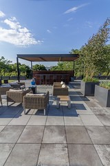 Bradley Low-Res3 (Chicago Roof Deck and Garden) Tags: pergola concrete porcelain roof deck chicagoroofdeck design landscape city landscapes roofdecks chicago outdoor spaces outdoorliving furniture synlawn ravenswood rooftop garden