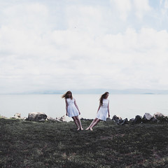 Drifting (laurawilliams) Tags: girls twins surreal surrealism landscape portrait girl sky clouds sea water lake mountains hair falling levitate levitation