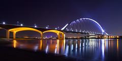 Over de Waal (zsnajorrah) Tags: urban architecture bridge church water river reflection night wideangle ultrawideangle uwa longexposure 7dmarkii efs1018mm netherlands nijmegen waal deoversteek oversteek snelbinder waalbrug