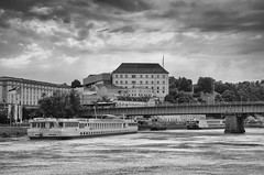 Linz (Tomsch) Tags: linz austria österreich oberösterreich upperaustria danube donau river fluss strom brücke bridge schiff ship water wasser sky himmel clouds wolken blackandwhite blackwhite scharzweiss bw sw