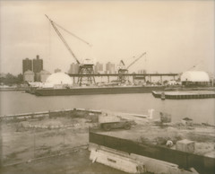 Brooklyn Navy Yard (daveknapik) Tags: nyc newyorkcity blackandwhite industry film sepia brooklyn clouds river polaroid industrial cloudy cranes rivers eastriver instant polaroidspectra spectra impossible brooklynnavyyard silvershade impossibleproject pz600